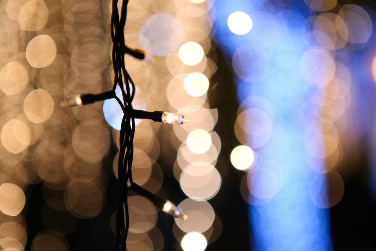 Close-up of illuminated string lights at night