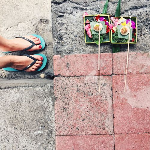 Daily offering at a Balinese house, Klungkung, Bali, Indonesia. Bali Bali, Indonesia Day Feet Flip Flops Flower High Angle View Human Body Part Human Hand INDONESIA IPhone IPhoneography Klungkung Multi Colored Nature One Person Outdoors People Real People Religion Religious  South East Asia Square