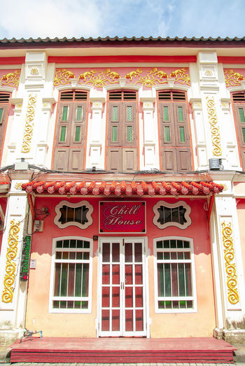 The image of the old Sino Portuguese architecture shows the design of the window from China, which is located in Phuket, Thailand. Architecture Light Phuket,Thailand Winter Architecture Building Exterior Built Structure China City Communication Decoration Door Entrance Landscape Light And Shadow Low Angle View Nature No People Old Buildings Outdoors Represents Sino-portuguese Architecture Street Sunrise Window