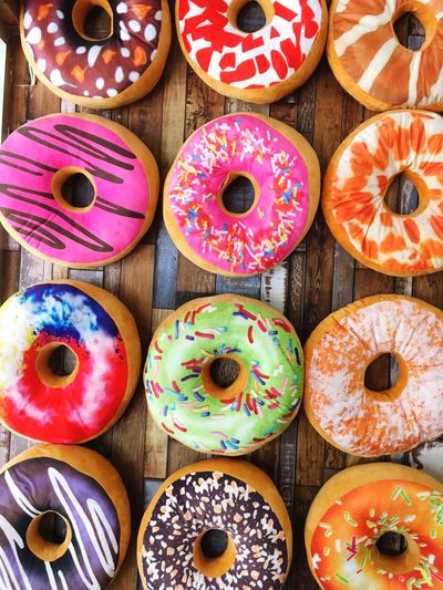 colorful giant donut Arrangement Choice Multi Colored Baked Food And Drink Sweet Food Food No People Still Life Group Of Objects Backgrounds In A Row Large Group Of Objects Donut Close-up