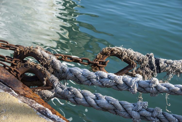 Close-up Connection Day High Angle View Metal Nature Nautical Vessel No People Outdoors Post Protection Rope Sea Security Strength Tied Knot Tied Up Transportation Turquoise Colored Water