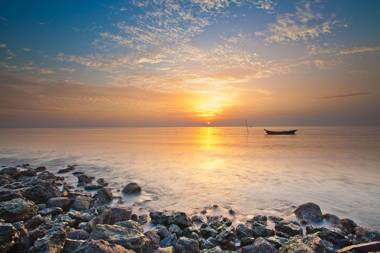 sunrise at kenjeran beach Sunset Beauty In Nature Rock Tranquil Scene Horizon Over Water Rock - Object Orange Color Tranquility Cloud - Sky Solid Sun Horizon Sky Nature Idyllic Beach Water Outdoors Sea Scenics - Nature No People