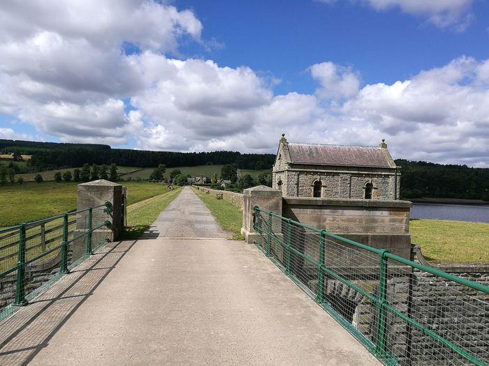 Narrow Walkway Leading To Bridge
