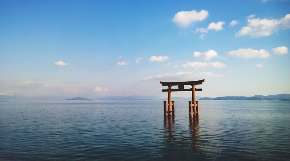 Torii Gate In Lake Biwa Against Sky