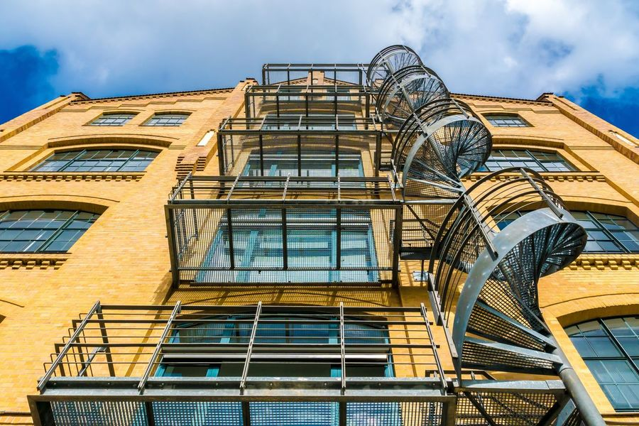 Architecture Building Exterior Built Structure Cloud - Sky Day Fire Escape Industrial Building  Industry Low Angle View No People Outdoors Sky Spiral Staircase Spiral Stairs Window