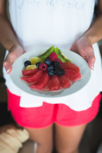 Breakfast Blueberry Cake Close-up Day Dessert Food Food And Drink Freshness Fruit Fruits Healthy Eating Human Hand Indoors  Lifestyles Men Midsection One Person Ready-to-eat Real People Red Room Service Standing Sweet Food Women