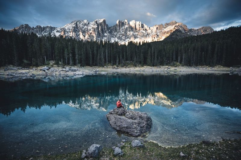 5 minutes of sunrise we'll spend. Nature Beauty In Nature Mountain Lake Rock - Object Scenics Tranquility Tranquil Scene Water Sky Non-urban Scene Reflection Real People Outdoors Leisure Activity Snow One Person Day Mountain Range Tree Dolomites, Italy
