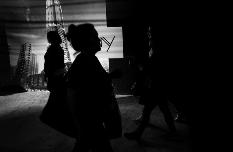 Side view of silhouette people walking at music concert