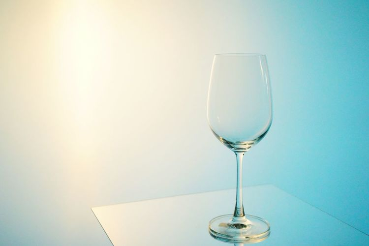 Close-Up Of Wineglass On Table Against Sky