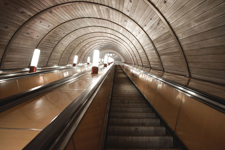 Elevated view of escalator in empty subway