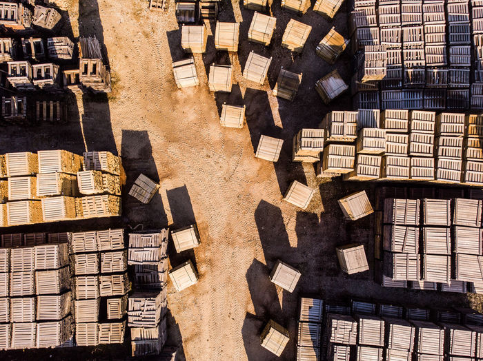 Aerial View Aerial Wood - Material Staves Cooperage Lumber Industry Lumber Large Group Of Objects Abundance Stack Sunlight No People High Angle View Industry Repetition Arrangement Day Block In A Row Built Structure Outdoors Still Life Nature Full Frame Construction Site Deforestation Wooden Pile Timber Forestry Industry 17.62°