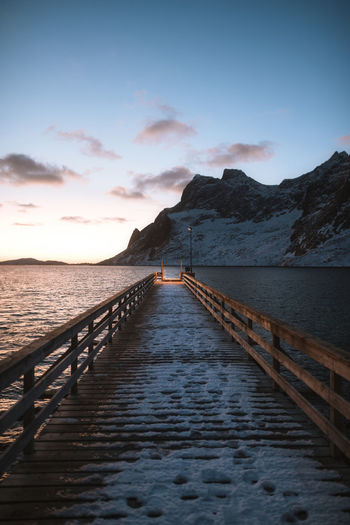 Early mornings in Lofoten Check out my prints at https://www.etsy.com/shop/simonmigajphoto and visit my IG http://www.instagram.com/simonmigaj for more inspirational photography from around the world. Sky Water Scenics - Nature Beauty In Nature Sea Tranquil Scene Tranquility Cloud - Sky Sunset Mountain The Way Forward Nature Railing Direction No People Pier Idyllic Wood - Material Non-urban Scene Outdoors Lofoten Cold Temperature Norway Jetty