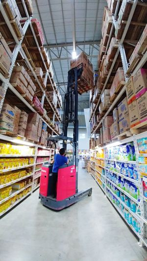 Full Length Ceiling Multi Colored Work Hazard Forklift Full Length Sitting Ceiling Day Multi Colored Hazardous Conditions Full Length Shop Around The Corner Groceries Grocery Shop Grocerystore High Up Standing Tall Amazing Machine