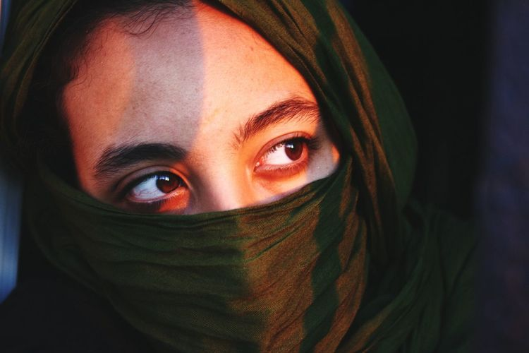Close-Up Of Teenage Girl Face Covered With Textile
