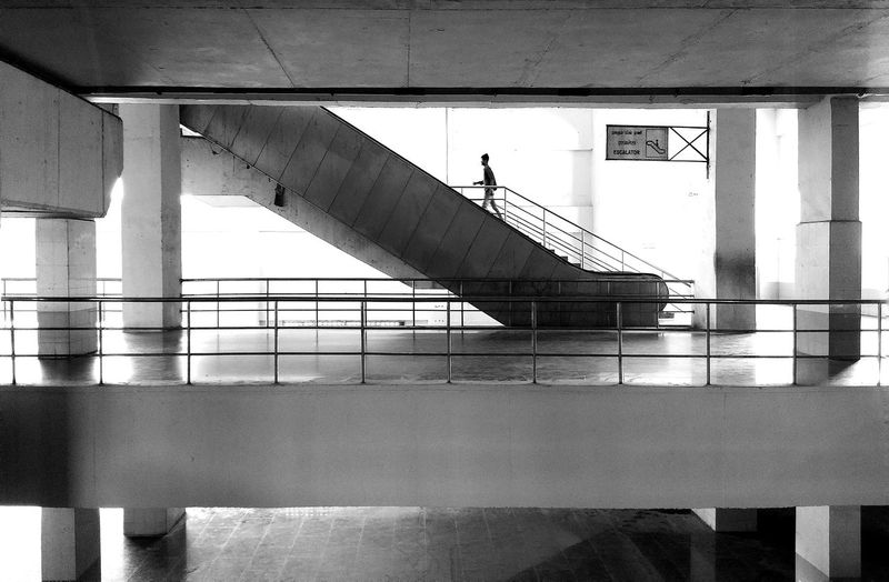 Man walking on staircase of building