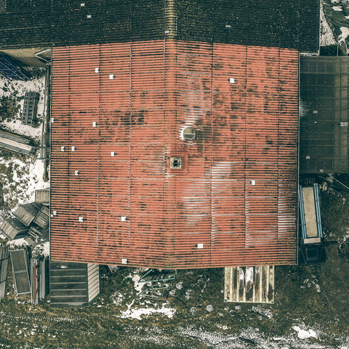 Abstract view from a vertical perspective of an old ugly annex on a shed, taken with the drone from the air. Architecture Built Structure Day Outdoors No People Wood - Material Building Exterior Nature Wall Brick Wall Building Container Directly Above Brick Wall - Building Feature Brown Absence Metal Field City Power Supply