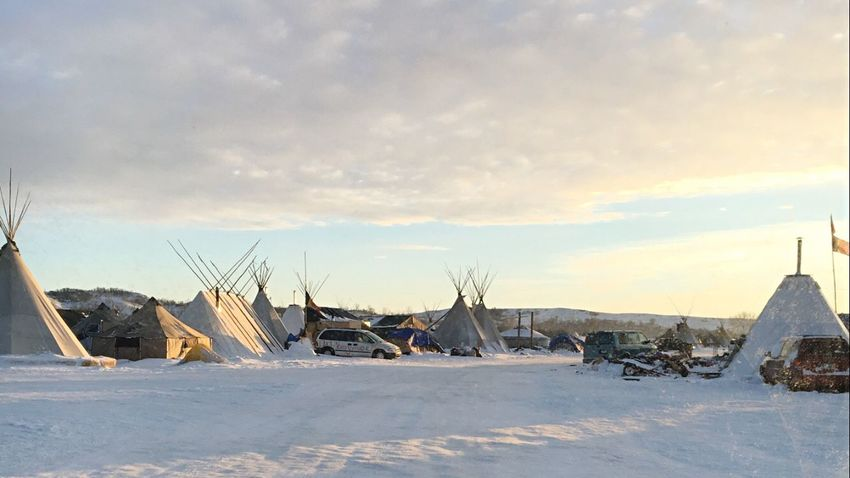 North Dakota Standing Rock Sioux Native American Ocetisakowin Tipi Snow Sunset