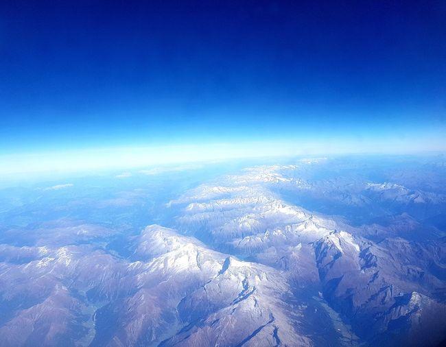The flight back home Alps Colour EyeEm Best Shots EyeEm Selects EyeEmBestPics Tadaa Community Picoftheday Europa EyeEmNewHere Astronomy Satellite View Space Planet Earth Galaxy Flying Blue
