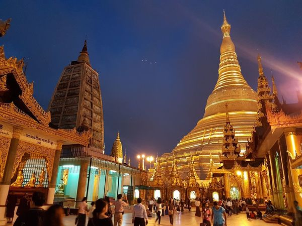 Shwedagon Pagoda Adult Adults Only Architecture Building Exterior Built Structure City Illuminated Large Group Of People Leisure Activity Lifestyles Men Night Outdoors People Place Of Worship Real People Religion Shwedagon Sky Spirituality Tourism Travel Destinations Women