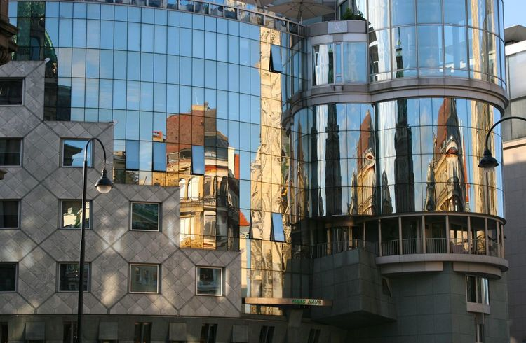 Harmony in stone 2 Colors Glass And Steel Architecture Brightly Lit Building Exterior Built Structure City Day Glass And Concrete Graded Low Angle View Modern No People Outdoors Reflexions Round And Angular Round Building Sky Statue Water Wien Vienna  Window