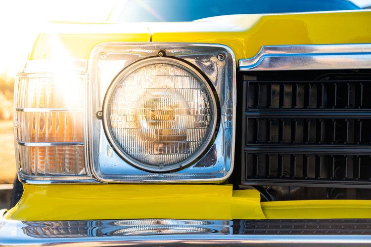 Close-up of yellow car headlight
