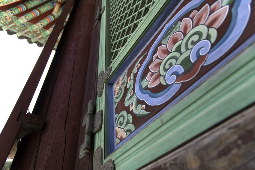 view of Bomunsa, a famous Buddhism temple at Seokmodo in Ganghwado, Kimpo, Gyeonggido, South Korea Bomunsa Buddhism Temple Seokmodo South Korea A Architecture Art And Craft Belief Buddhism Building Building Exterior Built Structure Close-up Day Floral Pattern Focus On Foreground Ganghwado House Low Angle View Multi Colored No People Ornate Outdoors Pattern Place Of Worship Religion Religious  Roof Temple Window Wood - Material