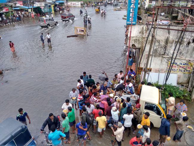 Chennai Flood Dec 2015 Flood relief Chennai Flood Crowd Flood Flood Relief Flooded Road Flooded Streets Food Distribution Large Group Of People Water