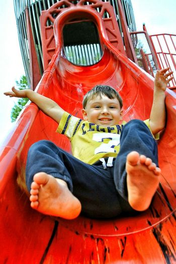 Childhood One Person Innocence Boys Child Portrait Playground Happiness Real People Outdoor Play Equipment Leisure Activity Outdoors Enjoyment Looking Lifestyles Mendocino County Cute Front View Red Slide - Play Equipment