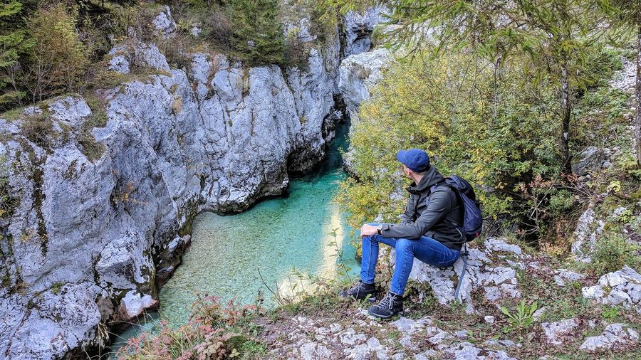 Real People Day Lifestyles One Person Sitting Men Outdoors Full Length Working Nature People Adult Landscape EyeEm Selects Young Adult Nature Slovenia Sitting Green Color Reflection Travel Destinations Cold Temperature Beauty In Nature Water Adventure