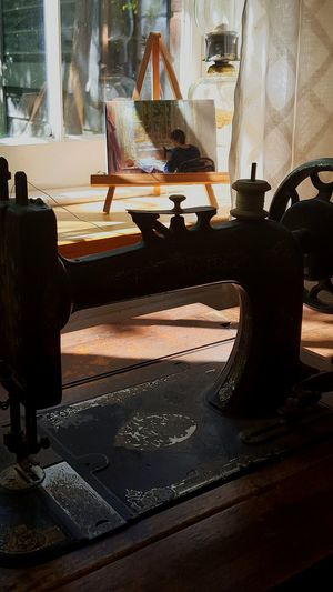 Old sewing machine Table Singer Sewing Sun Coming Through Window