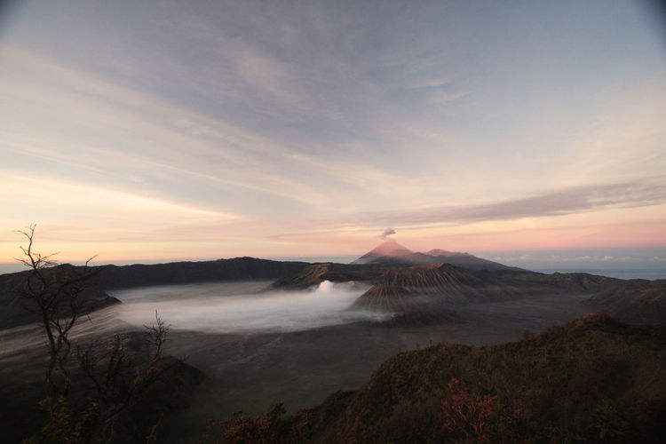 View of volcanic landscape against sky during sunrise