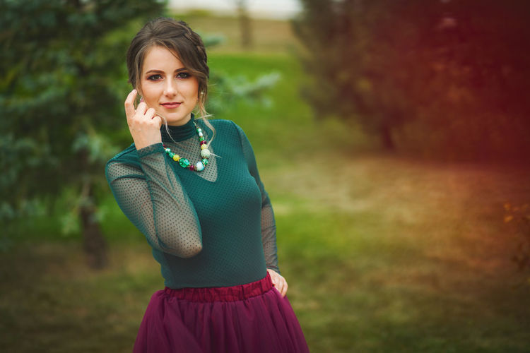 Artistic and natural portrait of beautiful woman in the nature. Woman Face Portrait Beautiful Beauty Smile Female Girl Young Hair Natural Nature Outdoors Skin White Happy Attractive Background Lifestyle Fashion Cute Skirt Green Purple Blouse One Person Looking At Camera Women Young Adult Focus On Foreground Front View Adult Standing Smiling Using Phone Telephone Jewelry Beautiful Woman Plant Casual Clothing Communication Hairstyle