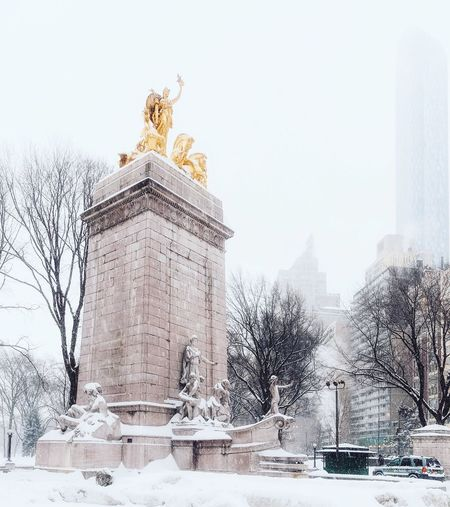 Statue in city during winter