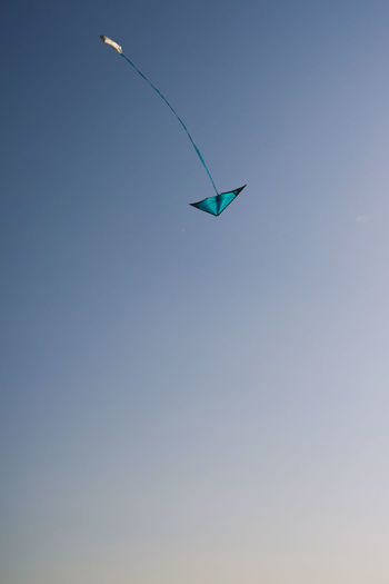 Low angle view of kite against clear sky