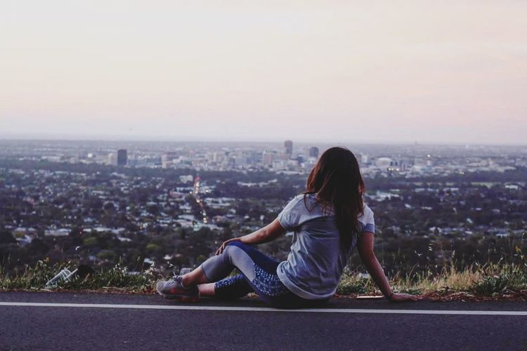 Woman sitting in city
