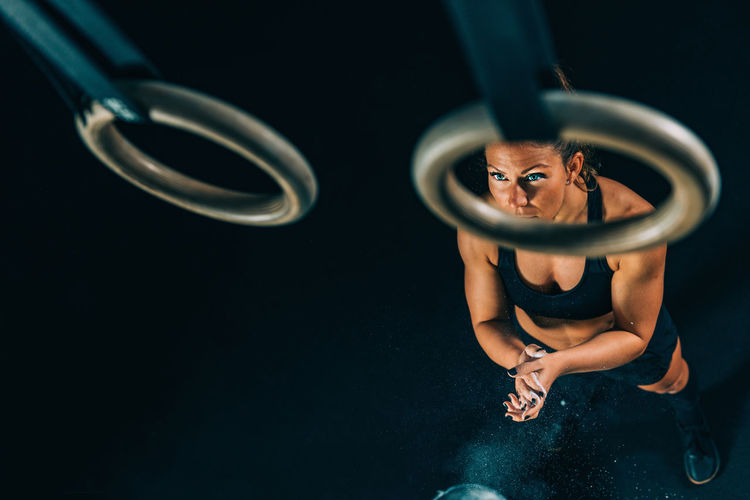 High angle view of woman over gymnastic rings