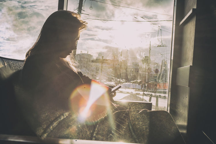 In counter light Adult Day Girl Looking Through Window One Person Reflection Russia Russian Girl Starbucks Starbucks Coffee Sunlight Sunset Window Winter