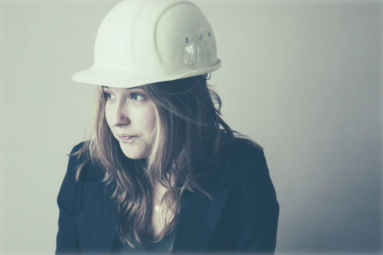 Beautiful girl with hard hat ARCHITECT Beautiful Builder Casual Clothing Close-up Confidence  Contracter Hard Hat Headshot Lifestyles Long Hair Portrait Pretty Side View Young Young Woman
