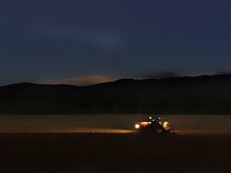 Farming in Maine at sunset by tractor lights. Sky Tractor Red Tractor Farming Farm Vehicles Agriculture Night Tractor Lights Mountain Silhouette Landscape Dark Outdoors Illuminated No People Headlight Betterlandscapes
