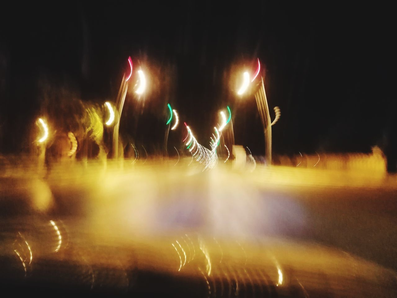 night, illuminated, blurred motion, motion, glowing, real people, long exposure, arts culture and entertainment, lifestyles, men, light - natural phenomenon, people, performance, light trail, group of people, standing, leisure activity, enjoyment, event, lighting equipment, nightlife, light, stage