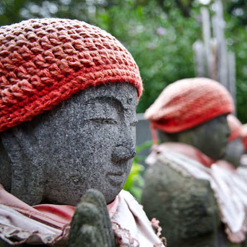 Japanese Tradition Statue Red Tradition Outdoors Sculpture Hat Art And Craft Japan Headshot Japanese Tradition Warm Clothing Nature Of Being