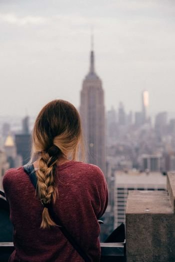 Woman Looking At Cityscape