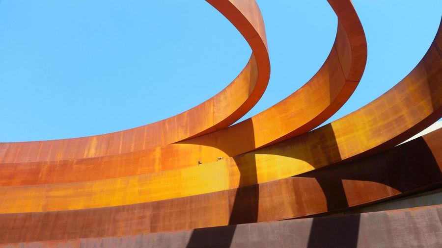 Low angle view of holon design museum building against blue sky