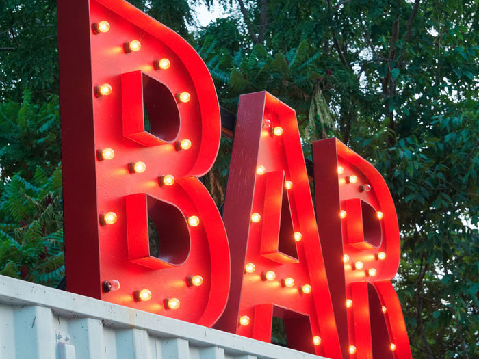 Sign Signs Bar Bar Sign Capital Letter Celebration Communication Illuminated Low Angle View Neon Outdoor Bar Red