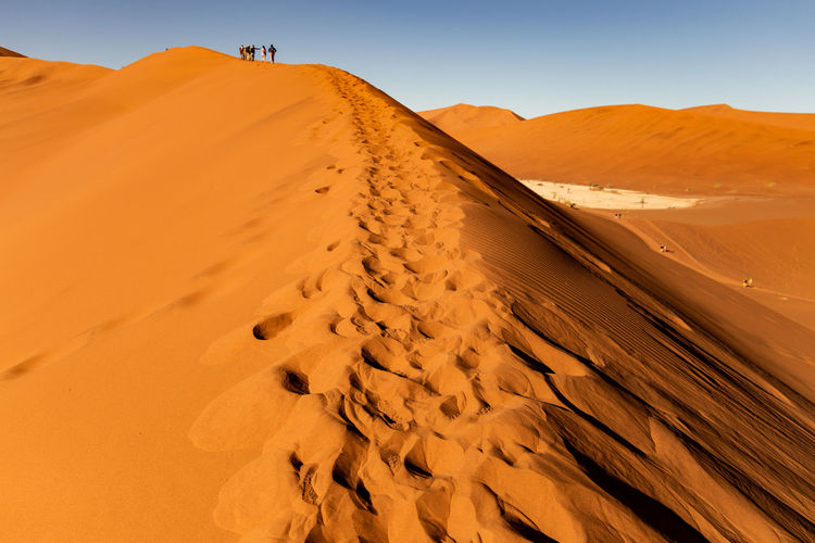 Hiking the dunes Deadvlei Dunes EyeEm Nature Lover EyeEmNewHere Hiking Namib Desert Namibia Nature Sossusvlei Africa Arid Climate Brown Climate Day Dead Desert Extreme Terrain Eye4photography  Land Landscape Remote Sand Sand Dune Scenics - Nature Sunlight
