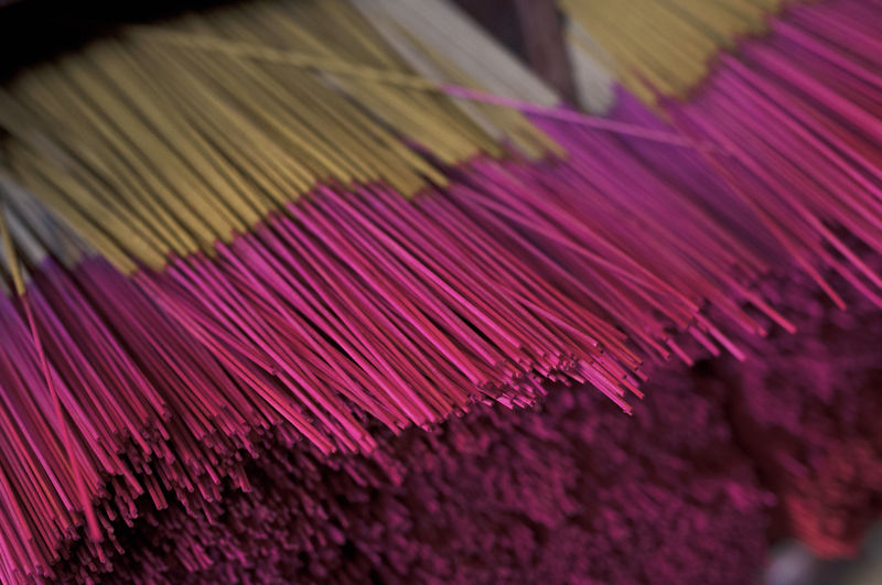 Close-up Indoors  Selective Focus No People Pink Color Textile Purple Pattern Industry Thread Large Group Of Objects Art And Craft Incense Still Life Textile Industry High Angle View Text Focus On Foreground Multi Colored Textured