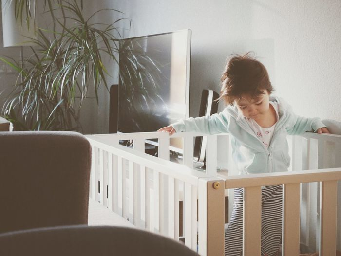 Baby Girl In Crib At Home