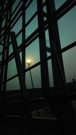 ✈️✈️ Transit ditemani sang mentari senja 🌆 ~170818 Bandarasoekarnohatta Built Structure Twilight Dusk In The City Electric Light Silhouette Lighting Pole Ligth_show Steel Structure  Sun EyeEmNewHere Astronomy Sunset Sky Architecture Power Line
