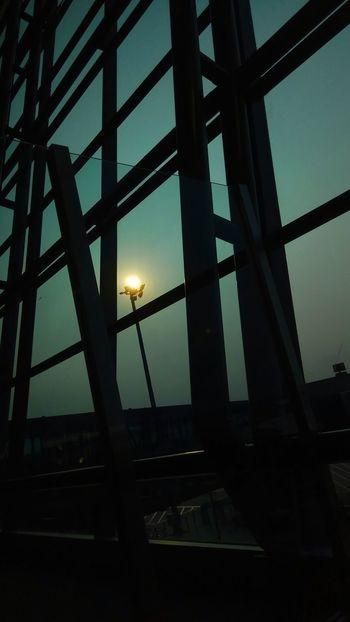 ✈️✈️ Transit ditemani sang mentari senja 🌆 ~170818 Bandarasoekarnohatta Built Structure Twilight Dusk In The City Electric Light Silhouette Lighting Pole Ligth_show Steel Structure  Sun EyeEmNewHere Astronomy Sunset Sky Architecture Power Line