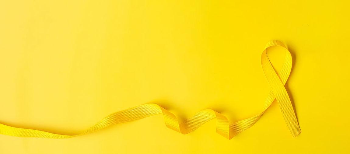 Yellow ribbon on yellow background